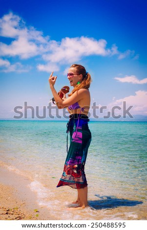 Bad Finger on the Beach  - stock photo