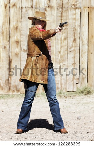bad girl shooting with a gun - stock photo