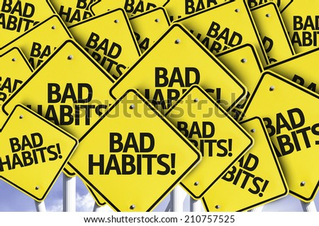 Bad Habits! written on multiple road sign  - stock photo