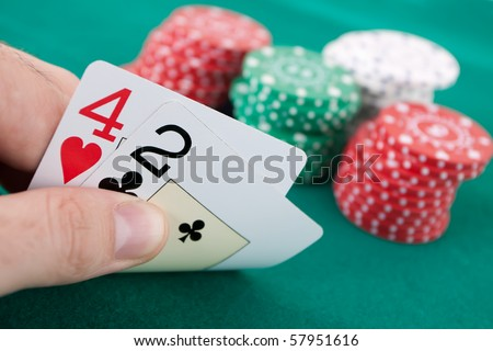 Bad hand in a poker game with chips. - stock photo