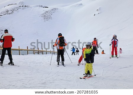 BAD HOFGASTEIN, AUSTRIA - JANUARY 09, 2013: Unidentified skiers enjoy skiing at the slope in the Austrian Alps, during the winter vacation, on famous ski resort Bad Hofgastein, Austria. - stock photo