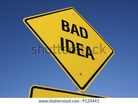 Bad Idea road sign with deep blue sky background. Contains clipping path. - stock photo