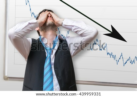 Bad investment or economic crisis concept. Businessman is disappointed from losing in stock exchange. Chart with arrow down on whiteboard in background. - stock photo