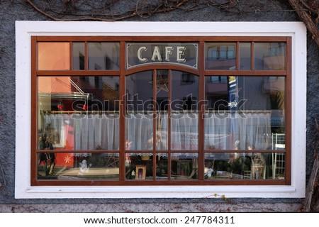 BAD ISCHL, AUSTRIA - DECEMBER 14: Window of coffee shop in Bad Ischl, Austria on December 14, 2014. - stock photo