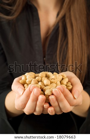 Bad job businesswoman working for peanuts or very little money - stock photo