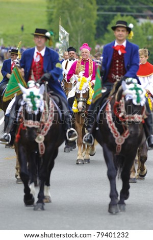 BAD KOETZTING, GERMANY - JUNE 13: bishop Mueller and 950 rider took part at the biggest german annual and 599th religious horse procession -Pfingstritt- at June 13, 2011 in Bad Koetzting, Germany - stock photo