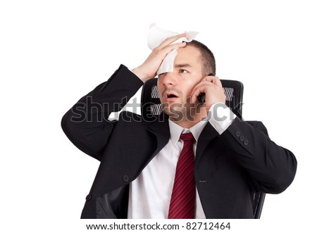 Bad news. Businessman holding forehead. Isolated on white background