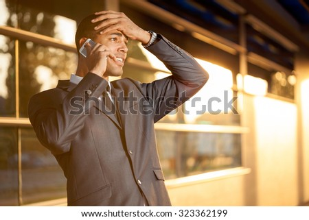 Bad news,businessman standing outdoors with office building - stock photo