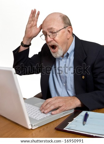 Bad news or a computer glitch results in a senior outburst of dismay. - stock photo