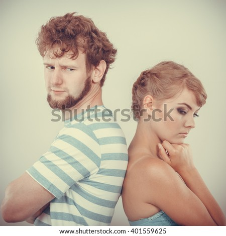 Bad relationship concept. Man and woman in disagreement. Young couple after quarrel offended back to back, not speaking to each other - stock photo