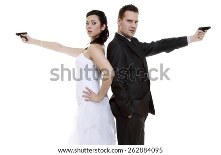 Bad relationship concept - married couple problem discord. Bride and groom with handgun. Man woman in disagreement. Isolated on white background - stock photo