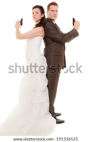 Bad relationship - married couple in conflict. Bride and groom with handgun weapon isolated on white. Man and woman in disagreement. Divorce. - stock photo
