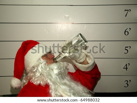 Bad Santa Santa Claus has been a bad bad boy this year and was arrested, and had his mugshot taken  Dark Christmas Humor images for all to enjoy - stock photo