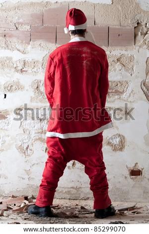 Bad Santa Urinating on a Wall - stock photo