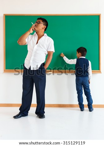 Bad teacher, poor education /  learning in the classroom / photo of teen school Chinese boy /  school theme