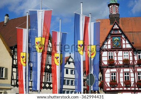 BAD URACH, GERMANY - CIRCA AUGUST 2015 Rathouse and flags on the Marktplatz square