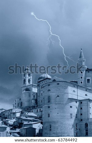bad weather and ancient tower - stock photo