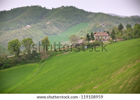 Bad Weather at Italy Farmland. Green Hills and House - Toned Vignetted Image