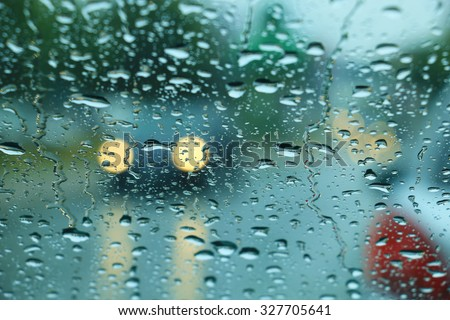 Bad weather, Car headlights. cars in motion. Traffic in poor visibility - stock photo