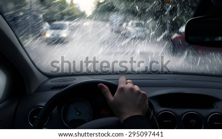 bad weather conditions on the road in the city - snowstorm - stock photo