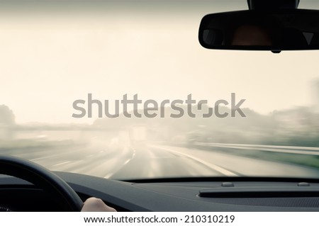 Bad Weather Driving - Driving on a Freeway on a Rainy and Misty Day - stock photo