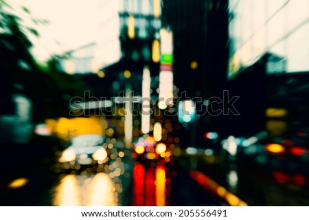 Bad weather driving in downtown / business district - stock photo
