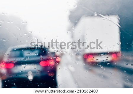 Bad Weather Driving on a Highway - Traffic Jam - stock photo