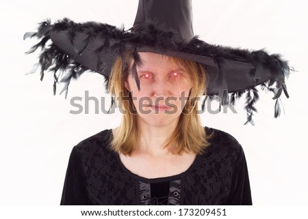 Bad witch of Dark Ages with evil eyes - stock photo