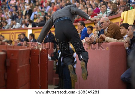 BADAJOZ, SPAIN, APRIL 12: Unidentified banderillero jumps into the lane after place the darts in the bull, on April 12, 2014 in Badajoz, Spain