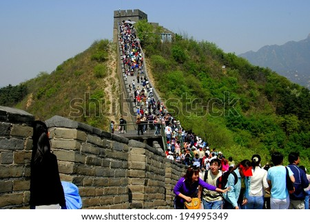 Badaling, China - May 1, 2005:  Throngs of tourists walking along the Great Wall of China at the popular Badaling section - stock photo