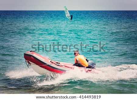 BADALONA, BARCELONA, SPAIN - APRIL 24, 2016: man in motor boat, maintenance person in the races swimming club Badalona
