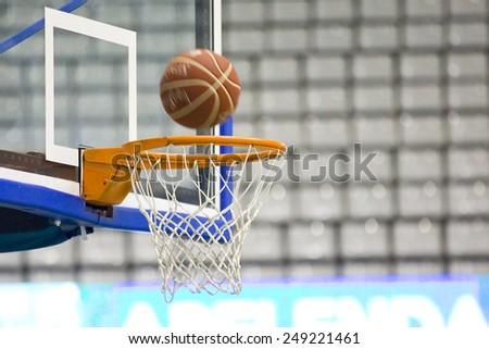 BADALONA, SPAIN - APRIL 13: Ball inside the basket net during Spanish Basketball League match between Joventut and Zaragoza, final score 82-57, on April 13, 2014, in Badalona, Spain. - stock photo