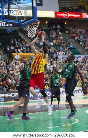 BADALONA, SPAIN - MAY 30: Ante Tomic of FCB in action at Spanish ACB Basketball League match between Joventut Badalona and FC Barcelona, final score 74-80, on May 30, 2015, in Badalona, Spain. - stock photo