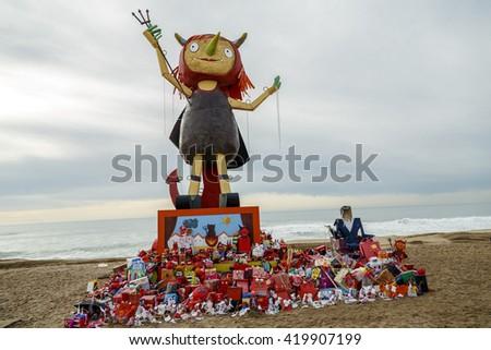 "BADALONA, SPAIN - MAY 10, 2016: Festes de Maig - Badalona during night of Saint Anastasi First year the traditional burning of the devil is a woman, ""The Dimonieta"" - stock photo"