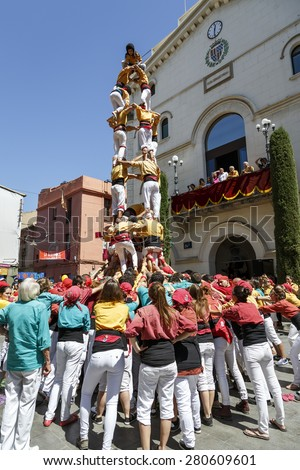 Badalona, Spain - May 17, 2015: Some unidentified people called Castellers do a Castell or Human Tower, typical tradition in Catalonia, in Badalona Barcelona, Spain. - stock photo