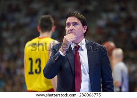 BADALONA, SPAIN - MAY 30: Xavi Pascual, coach of FCB, at Spanish ACB Basketball League match between Joventut Badalona and FC Barcelona, final score 74-80, on May 30, 2015, in Badalona, Spain. - stock photo