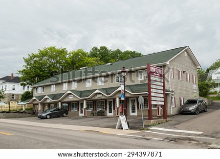 BADDECK, CANADA - 5TH JULY 2015: The outside of the Chebucto Place stores in Baddeck Nova Scotia during the day