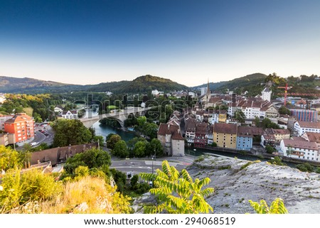 BADEN, AARGAU, SWITZERLAND - JULY 1: Exterior view from Wettingen side at sunset to the city of Baden and river Limmat on July 1, 2015. Baden is a municipality in the Swiss canton of Aargau.