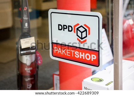 BADEN-BADEN, GERMANY - NOV 20, 2014: DPD Paket Shop logo on the entrance of a shop offering pick-up service for online orders. DPD is a parcel delivery company owned by GeoPost La Poste France
