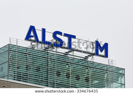 BADEN, SWITZERLAND. November 2nd 2015. Alstom logo on rooftop of thermal power headquarters being removed for merger and acquisition of General Electric. - stock photo