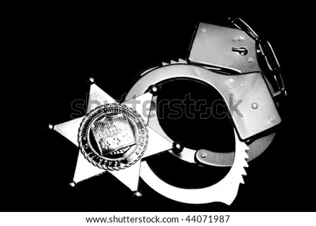 Badge and handcuffs - stock photo