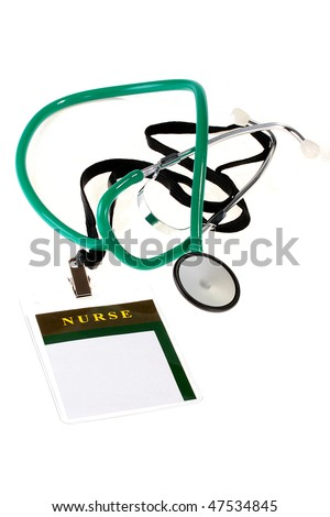 Badge for the staff nurse together with a stethoscope. - stock photo