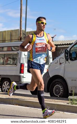"""BADIA DEL VALLES, BARCELONA, SPAIN - APRIL 17, 2016: Unidentified runner in the track during the event of """" La Cursa Badia 10K"""", popular race in Badia del Valles village, Barcelona, Spain. - stock photo"""