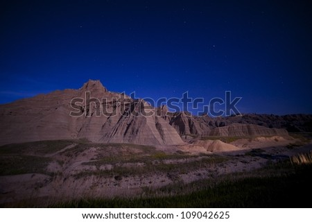 Badlands at Night. South Dakotas Badlands National Park at Night. Clear Sky with Many Stars. Nature Photo Collection. - stock photo