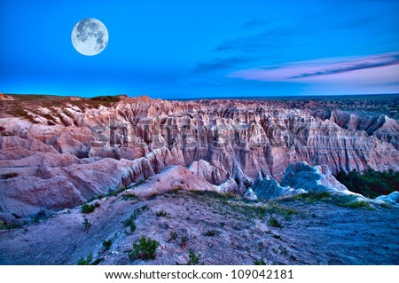 Badlands Dusk (HDR) with Full Moon on the Sky. Beautiful Scenic Photography. Badlands National Park, U.S.A. - stock photo