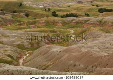 Badlands National Park landscape image, showing sparse vegetation - stock photo