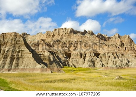 Badlands Prairie Landscape. Summer Cloudy Day in the Badlands NP, SD, USA. US National Parks Photo Collection - stock photo