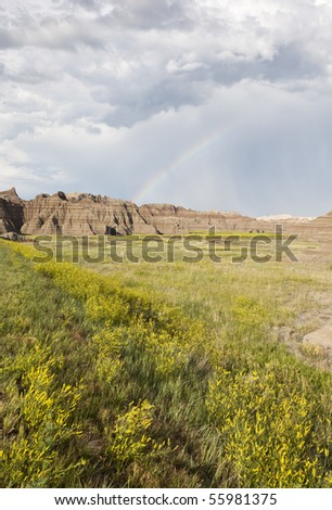 Badlands Wilderness with rainbow, Badlands National Park, South Dakota, United States - stock photo