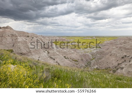 Badlands Wilderness with upcoming thunderstorm, Badlands National Park, South Dakota, United States - stock photo