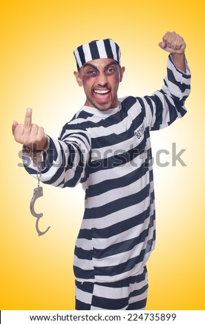 Badly bruised prisoner with handcuffs - stock photo